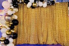 Organic-Balloon-Garland-Over-Gold-Cloth-Backdrop