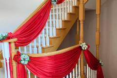Red Drape Decor With Flower Bunches