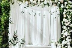 White Backdrop With Floral & Leaf Vine Decor